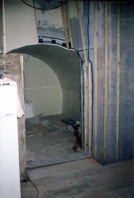 Cellar corner in the main room showing vertical battens screwed to the plug heads