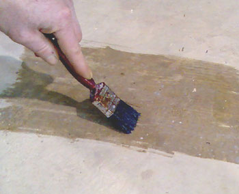 Brushing clear Epoxy Seal Coat onto concrete - clean concrete well first
