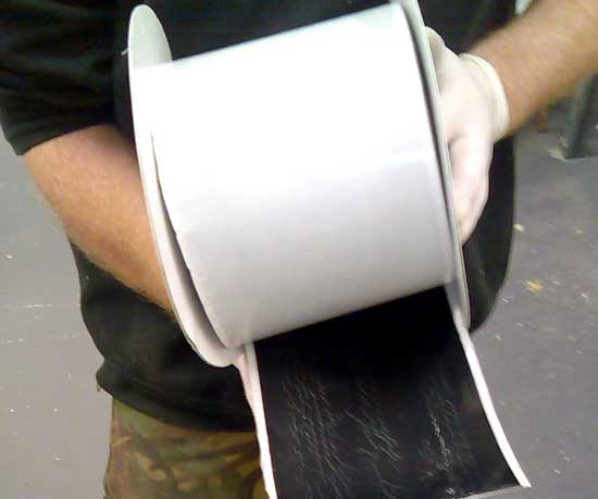 Wide single sided tape for reinforcement of corners and joints in Membranes